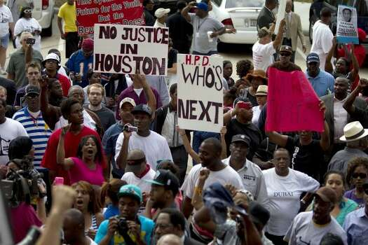 Marchers at the protest. (Brett Coomer / Houston Chronicle)