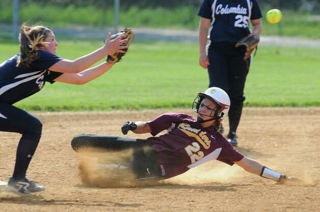 Colonie's Marisa Sholtes steals second base as Columbia shortstop Haley VanVorst awaits the throw, during their rain shortened 2-0 victory over Columbia on Wednesday May 16, 2012 in Colonie, NY.   (Philip Kamrass / Times Union ) Photo: Philip Kamrass / 00017717A