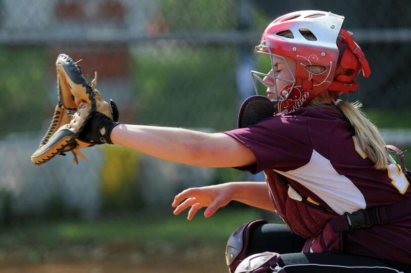Colonie catcher Kassidy Ogren receives a pitch from Kelly Lane during their rain shortened 2-0 victo