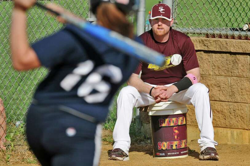 Colonie girls softball coach Kevin Jette watches Columbia's Haley VanVorst take practice swings, dur