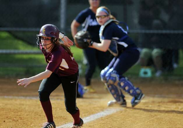 Colonie's Devon Coffey is caught  in a rundown as Columbia catcher Jen Knox prepares to throw to third, during their rain shortened 2-0 victory over Columbia on Wednesday May 16, 2012 in Colonie, NY.  Coffey was tagged out. (Philip Kamrass / Times Union ) Photo: Philip Kamrass / 00017717A