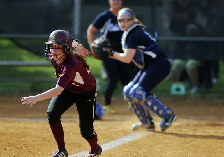 Colonie's Devon Coffey is caught  in a rundown as Columbia catcher Jen Knox prepares to throw to thi