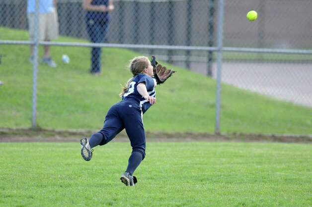 Columbia centerfielder Natasha Schultz dives for the ball during their rain shortened 2-0 loss to Colonie on Wednesday May 16, 2012 in Colonie, NY.   (Philip Kamrass / Times Union ) Photo: Philip Kamrass / 00017717A