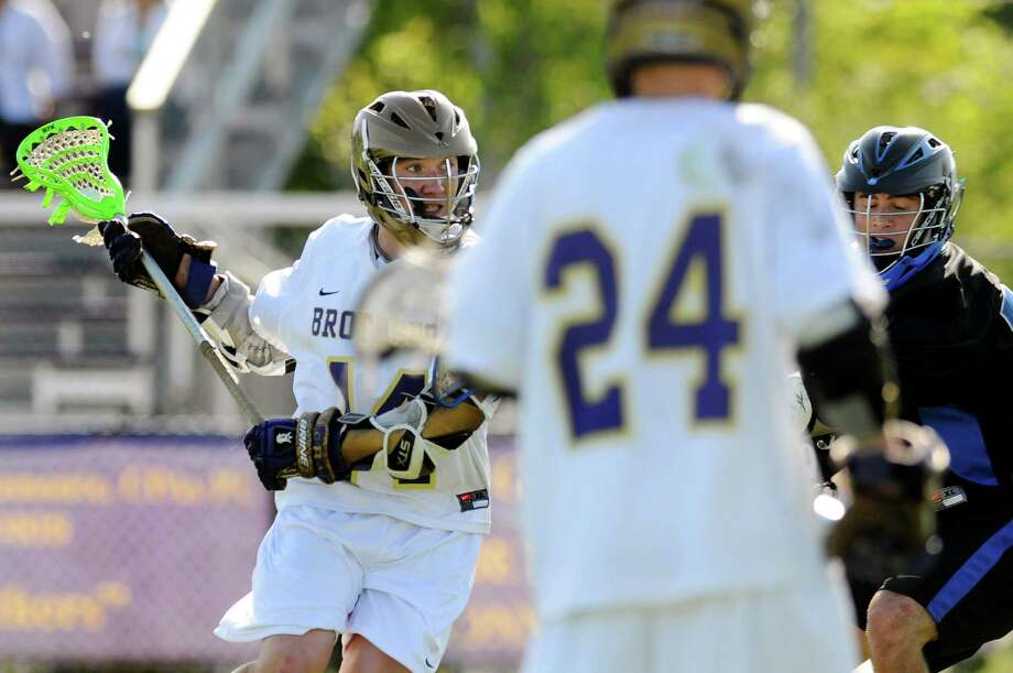 CBA's John Bassett(14), left, winds up to shoot on net and score during their lacrosse game against LaSalle on Thursday, May 17, 2012, at Christian Brothers Academy in Colonie, N.Y. (Cindy Schultz / Times Union) Photo: Cindy Schultz / 00017677A
