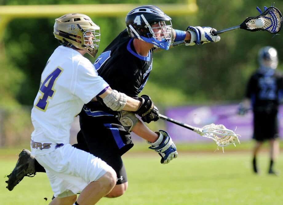 LaSalle's Alex Daversa-Russo (4), center, gets tripped up from CBA's James Bell (44), left, which draws a penalty during their lacrosse game on Thursday, May 17, 2012, at Christian Brothers Academy in Colonie, N.Y. (Cindy Schultz / Times Union) Photo: Cindy Schultz / 00017677A