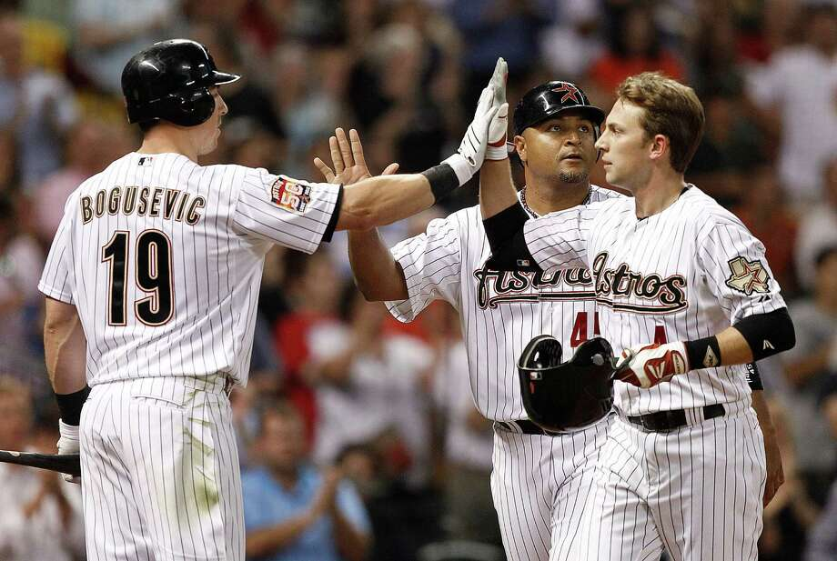 May 17: Astros 4, Brewers 0 ... Jed Lowrie #4 of the Houston Astros receives high fives from Brian Bogusevic and Carlos Lee after hitting a two-run home run in the fourth inning. Photo: Bob Levey, Getty Images / 2012 Getty Images