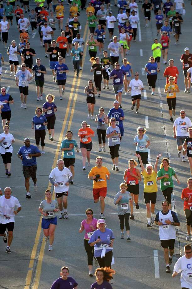 Runners approach the finish line during the CDPHP Workforce Team Challenge on Thursday, May 17, 2012, in Albany, N.Y. (Cindy Schultz / Times Union) Photo: Cindy Schultz / 00017680A