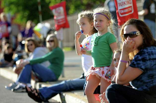 Riley McQueeney, 4, of Niskayuna, center, and her friend Piper Catanese, 4, of Clifton Park wait for the runners near the finish line during the CDPHP Workforce Team Challenge on Thursday, May 17, 2012, in Albany, N.Y. (Cindy Schultz / Times Union) Photo: Cindy Schultz / 00017680A
