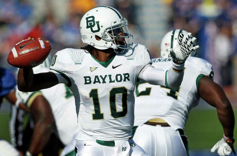FOR USE AS DESIRED WITH NFL DRAFT STORIES - FILE - In this Nov. 12, 2011, file photo, Baylor quarterback Robert Griffin III (10) drops back to pass during the first half of an NCAA college football game against Kansas in Lawrence, Kan. Griffin is a top prospect in the upcoming NFL football draft. (AP Photo/Orlin Wagner, File) Photo: Orlin Wagner, Associated Press / AP2011