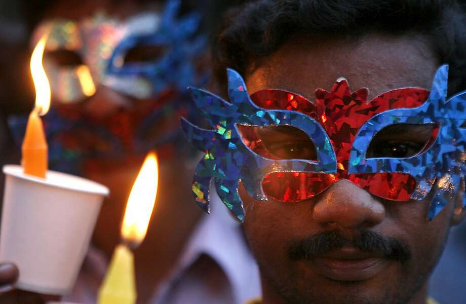 An Indian participates in a candlelight vigil organized by members and supporters of the lesbian, gay, bisexual and transgender community to mark International Day Against Homophobia in Chennai, India, Thursday, May 17, 2012. Over the last decade, homosexuals have slowly gained a degree of acceptance in some parts of India, especially its big cities. Still, being gay remains deeply taboo in most of the country, and many gays and lesbians hide their sexual orientation from friends and relatives. (AP Photo/Arun Sankar K.) Photo: Arun Sankar K., Associated Press