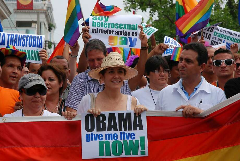 The Director of the Cuban National Center for Sex Education (CENESEX) Mariela Castro (C), daughter of President Raul Castro, participates in a march against homophobia on May 17, 2012 in Cienfuegos. Mariela has been granted a visa to attend an academic conference in San Francisco later this month, a spokesman said Wednesday. Castro, 50, will attend the annual conference of the Latin American Studies Association on May 23-26 in San Francisco, and sources said she would be on a panel tackling the issue of sexual diversity.    AFP PHOTO/STRSTR/AFP/GettyImages Photo: Str, AFP/Getty Images