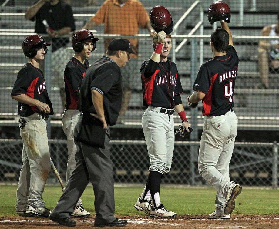 Dane Balazs is met by teammates after a 3 run homer in the fifth inning  for the Cavaliers as Clemens plays Lake Travis in playoff baseball at Judson High School  on May 17, 2012.  Tom Reel/ San Antonio Express-News Photo: TOM REEL, Express-News / San Antonio Express-News