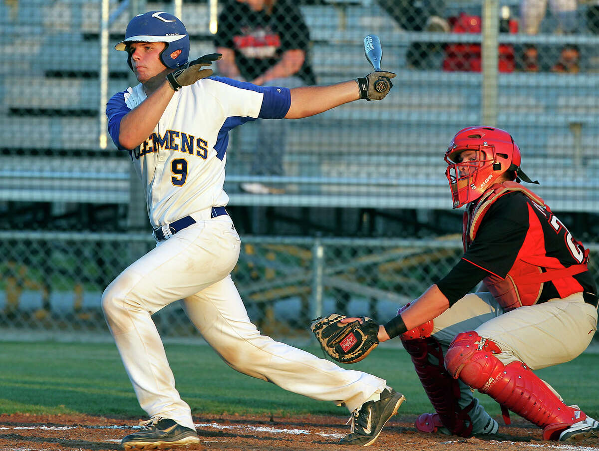 Garret Kizer gets a hit for a single in the second inning as Clemens plays Lake Travis in playoff baseball at Judson High School on May 17, 2012. Tom Reel/ San Antonio Express-News