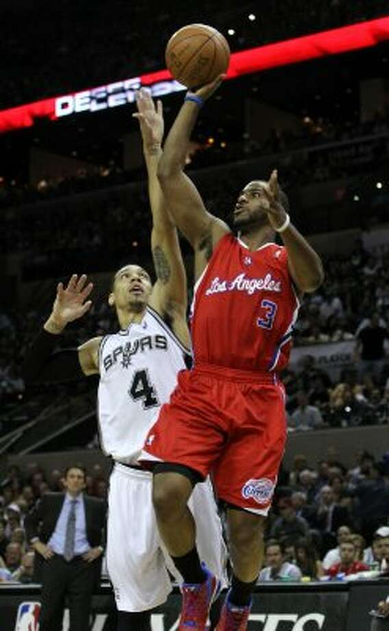 Los Angeles Clippers' Chris Paul (3) shoots over San Antonio Spurs' Danny Green (4) in the first half of game two of the Western Conference semifinals at the AT&T Center on Thursday, May 17, 2012. Kin Man Hui/Express-News (SAN ANTONIO EXPRESS-NEWS)