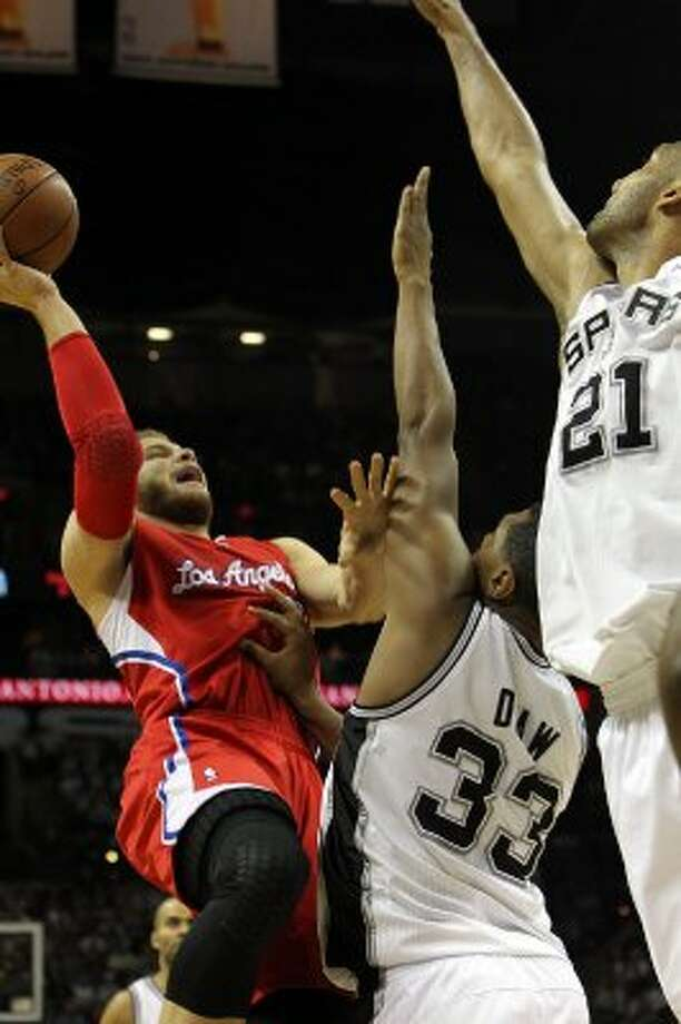 Los Angeles Clippers' Blake Griffin (32) shoots against San Antonio Spurs' Boris Diaw (33) and Tim Duncan (21) in the first half of game two of the Western Conference semifinals at the AT&T Center on Thursday, May 17, 2012. Kin Man Hui/Express-News (SAN ANTONIO EXPRESS-NEWS)