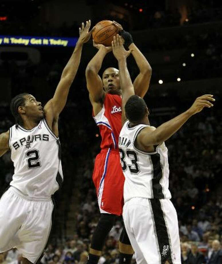 Los Angeles Clippers' Caron Butler (5) passes over San Antonio Spurs' Kawhi Leonard (2) and San Antonio Spurs' Boris Diaw (33) in the first half of game two of the Western Conference semifinals at the AT&T Center on Thursday, May 17, 2012. Kin Man Hui/Express-News (SAN ANTONIO EXPRESS-NEWS)