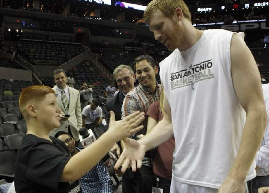 Woodlake Hills Middle School student Patrick Gonzalez, left, greets San Antonio Spurs forward Matt Bonner before game two of the Western Conference semifinals at AT&T Center, Thursday May 17, 2012.  Gonzalez was told by Woodlake school officials to shave a likeness of Bonner off the back of his head after showing up to school.  Bonner gave Gonzalez game tickets for his family, a signed jersey and shoes.  Jerry Lara/San Antonio Express-News (San Antonio Express-News)