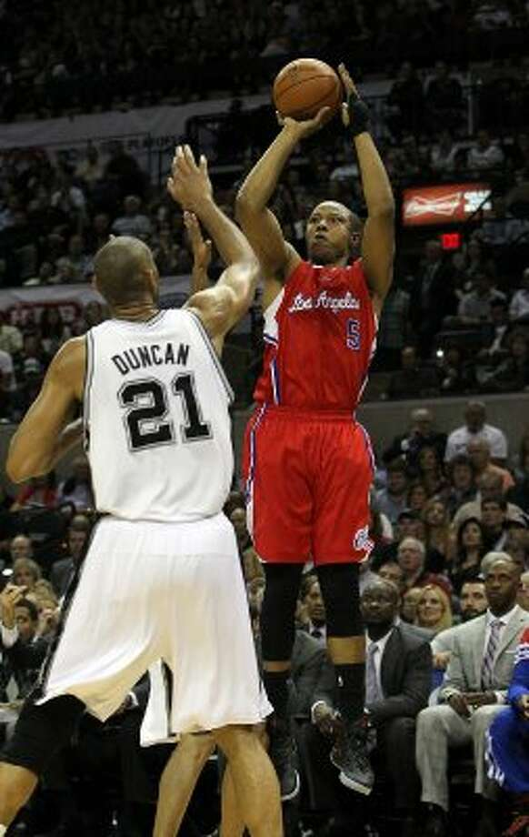 Los Angeles Clippers' Caron Butler (5) shoots over San Antonio Spurs' Tim Duncan (21) in the first half of game two of the Western Conference semifinals at the AT&T Center on Thursday, May 17, 2012. Kin Man Hui/Express-News (SAN ANTONIO EXPRESS-NEWS)