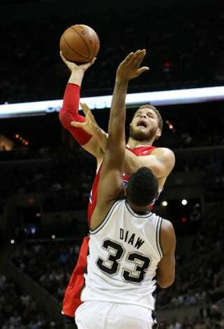 Los Angeles Clippers' Blake Griffin (32) shoots over San Antonio Spurs' Boris Diaw (33) in the first half of game two of the Western Conference semifinals at the AT&T Center on Thursday, May 17, 2012. Kin Man Hui/Express-News (SAN ANTONIO EXPRESS-NEWS)