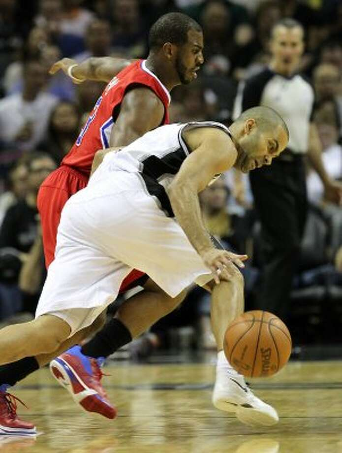 San Antonio Spurs' Tony Parker (9) dribbles against  Los Angeles Clippers' Chris Paul (3) in the first half of game two of the Western Conference semifinals at the AT&T Center on Thursday, May 17, 2012. Kin Man Hui/Express-News (SAN ANTONIO EXPRESS-NEWS)