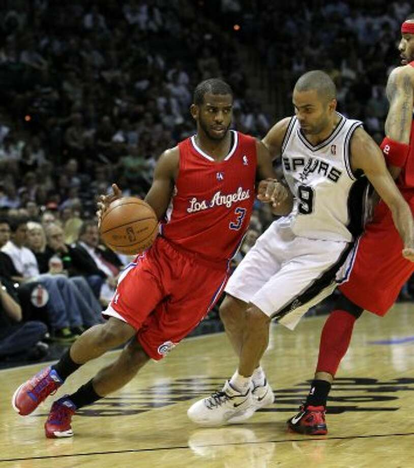 Los Angeles Clippers' Chris Paul (3) drives against San Antonio Spurs' Tony Parker (9) in the first half of game two of the Western Conference semifinals at the AT&T Center on Thursday, May 17, 2012. Kin Man Hui/Express-News (SAN ANTONIO EXPRESS-NEWS)