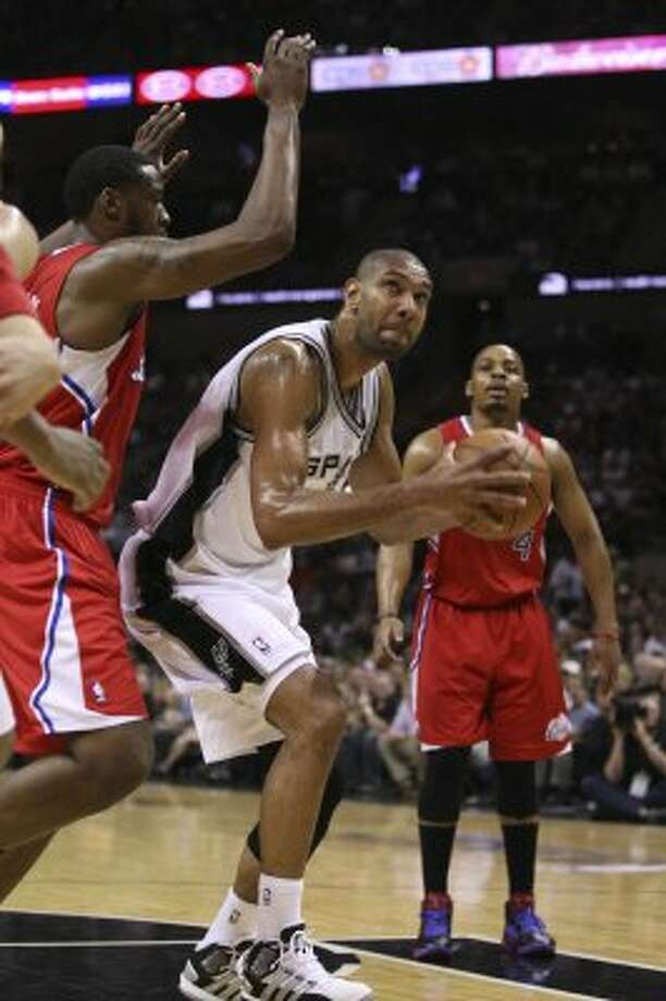 San Antonio Spurs' Tim Duncan (21) drives against  Los Angeles Clippers' DeAndre Jordan (6) during the first half of game two of the Western Conference semifinals at AT&T Center, Thursday, May 17, 2012.  Jerry Lara/San Antonio Express-News (San Antonio Express-News)