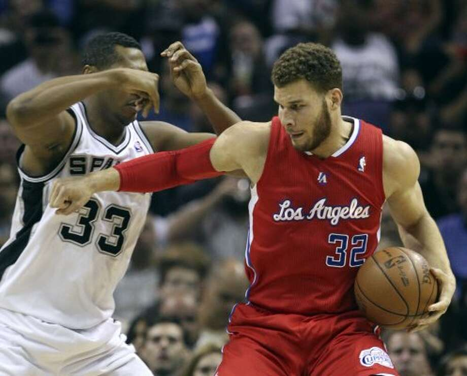 Los Angeles Clippers' Blake Griffin (32) fends off San Antonio Spurs' Boris Diaw (33) during the first half of game two of the Western Conference semifinals at AT&T Center, Thursday, May 17, 2012.  Jerry Lara/San Antonio Express-News (San Antonio Express-News)