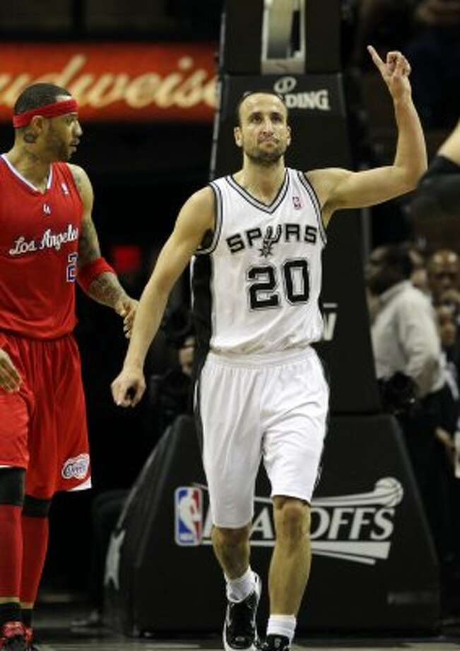 San Antonio Spurs' Manu Ginobili (20)  reacts near  Los Angeles Clippers' Kenyon Martin (2) in the first half of game two of the Western Conference semifinals at the AT&T Center on Thursday, May 17, 2012. Kin Man Hui/Express-News (SAN ANTONIO EXPRESS-NEWS)