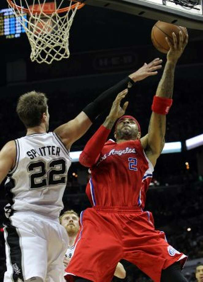Los Angeles Clippers' Kenyon Martin (2) shoots over San Antonio Spurs' Tiago Splitter (22) in the first half of game two of the Western Conference semifinals at the AT&T Center on Thursday, May 17, 2012. Kin Man Hui/Express-News (SAN ANTONIO EXPRESS-NEWS)