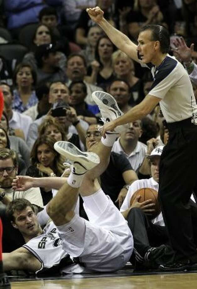 San Antonio Spurs' Tiago Splitter (22) takes a spill in the first half of game two of the Western Conference semifinals at the AT&T Center on Thursday, May 17, 2012. Kin Man Hui/Express-News (SAN ANTONIO EXPRESS-NEWS)