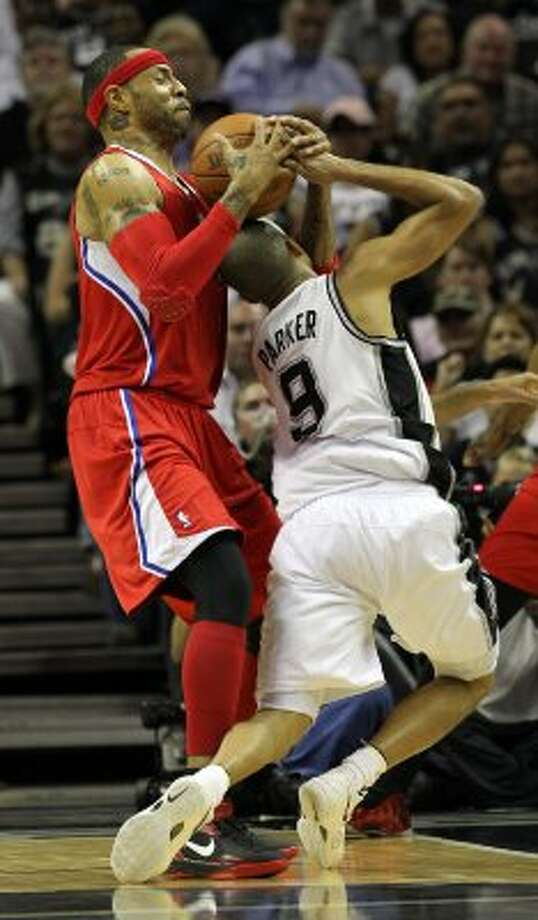 Los Angeles Clippers' Kenyon Martin (2) takes the ball away from San Antonio Spurs' Tony Parker (9) in the first half of game two of the Western Conference semifinals at the AT&T Center on Thursday, May 17, 2012. Kin Man Hui/Express-News (SAN ANTONIO EXPRESS-NEWS)