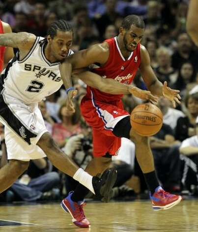 Kawhi Leonard wearing the Black Patent Air Jordan 12 Low and Josh Howard in an iD version of the Air Jordan 2012, respectively