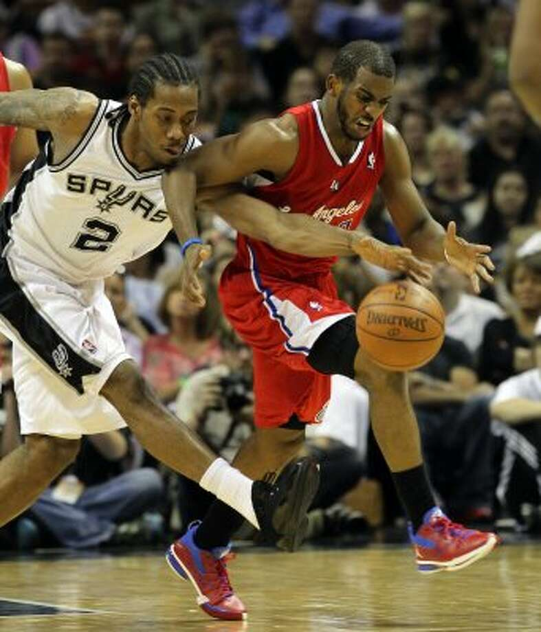 San Antonio Spurs' Kawhi Leonard (2) chases the ball against  Los Angeles Clippers' Chris Paul (3) in the first half of game two of the Western Conference semifinals at the AT&T Center on Thursday, May 17, 2012. Kin Man Hui/Express-News (SAN ANTONIO EXPRESS-NEWS)