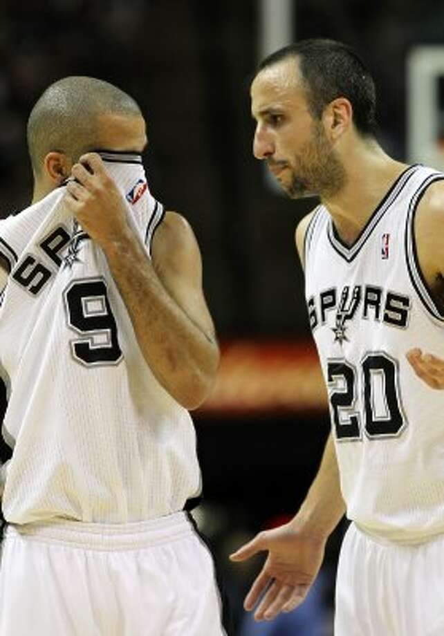 San Antonio Spurs' Manu Ginobili (20)  talks to San Antonio Spurs' Tony Parker (9) in the first half of game two of the Western Conference semifinals at the AT&T Center on Thursday, May 17, 2012. Kin Man Hui/Express-News (SAN ANTONIO EXPRESS-NEWS)