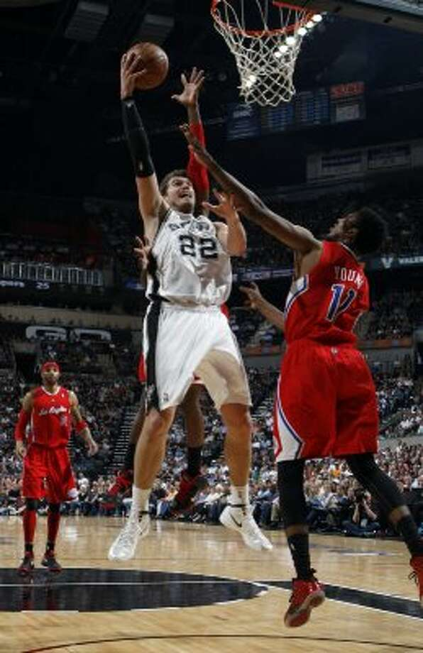 San Antonio Spurs' Tiago Splitter (22) shoots over  Los Angeles Clippers' Nick Young (11) during the first half of game two of the Western Conference semifinals at AT&T Center, Thursday, May 17, 2012.  Jerry Lara/San Antonio Express-News (San Antonio Express-News)