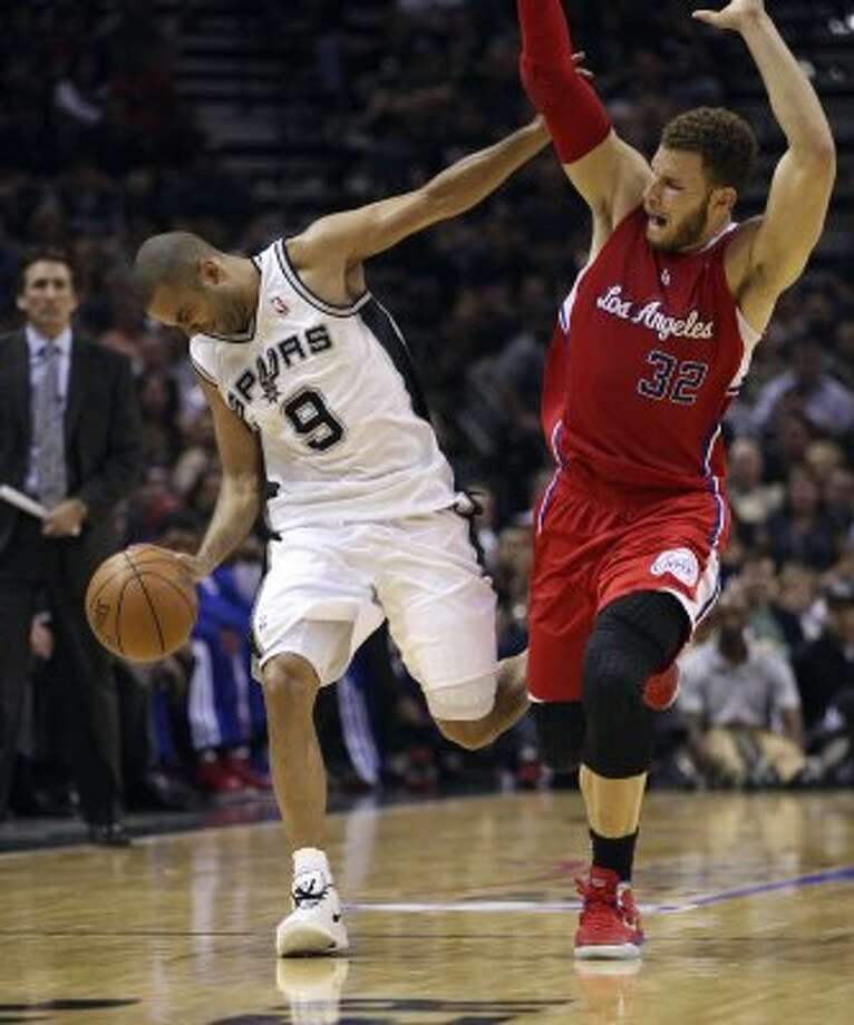 San Antonio Spurs' Tony Parker (9) reacts after contact with  Los Angeles Clippers' Blake Griffin (32) during the first half of game two of the Western Conference semifinals at AT&T Center, Thursday, May 17, 2012.  Jerry Lara/San Antonio Express-News (San Antonio Express-News)