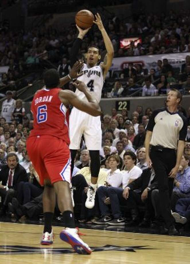 San Antonio Spurs' Danny Green (4) shoots over  Los Angeles Clippers' DeAndre Jordan (6) during the first half of game two of the Western Conference semifinals at AT&T Center, Thursday, May 17, 2012.  Jerry Lara/San Antonio Express-News (San Antonio Express-News)