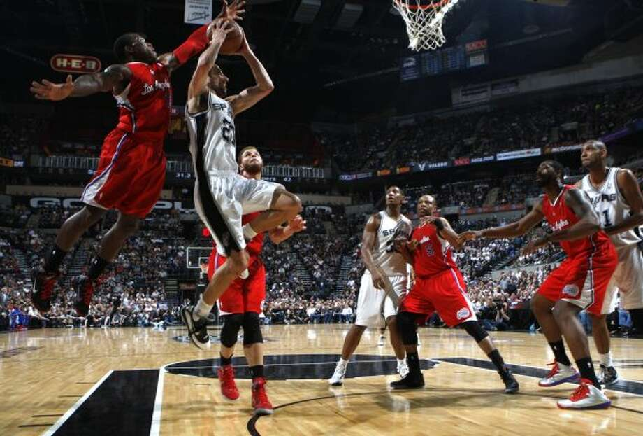 San Antonio Spurs' Manu Ginobili (20) shoots past  Los Angeles Clippers' Eric Bledsoe (12) during the first half of game two of the Western Conference semifinals at AT&T Center, Thursday, May 17, 2012.  Jerry Lara/San Antonio Express-News (San Antonio Express-News)