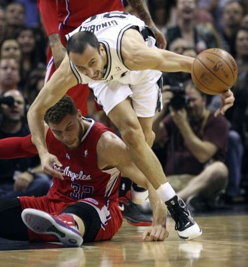 San Antonio Spurs' Manu Ginobili (20)  goes for a loose ball against  Los Angeles Clippers' Blake Griffin (32) during the first half of game two of the Western Conference semifinals at AT&T Center, Thursday, May 17, 2012.  Jerry Lara/San Antonio Express-News (San Antonio Express-News)