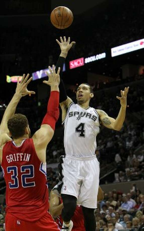 San Antonio Spurs' Danny Green (4) shoots over  Los Angeles Clippers' Blake Griffin (32) in the second half of game two of the Western Conference semifinals at the AT&T Center on Thursday, May 17, 2012. Kin Man Hui/Express-News (SAN ANTONIO EXPRESS-NEWS)