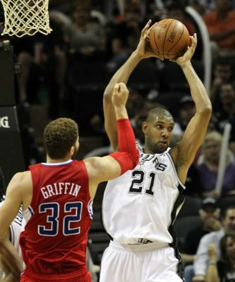 San Antonio Spurs' Tim Duncan (21) pulls in a rebound near  Los Angeles Clippers' Blake Griffin (32) in the second half of game two of the Western Conference semifinals at the AT&T Center on Thursday, May 17, 2012. Kin Man Hui/Express-News (SAN ANTONIO EXPRESS-NEWS)