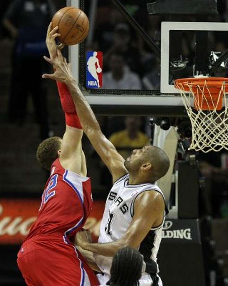 San Antonio Spurs' Tim Duncan (21) fouls  Los Angeles Clippers' Blake Griffin (32) in the second half of game two of the Western Conference semifinals at the AT&T Center on Thursday, May 17, 2012. Kin Man Hui/Express-News (SAN ANTONIO EXPRESS-NEWS)