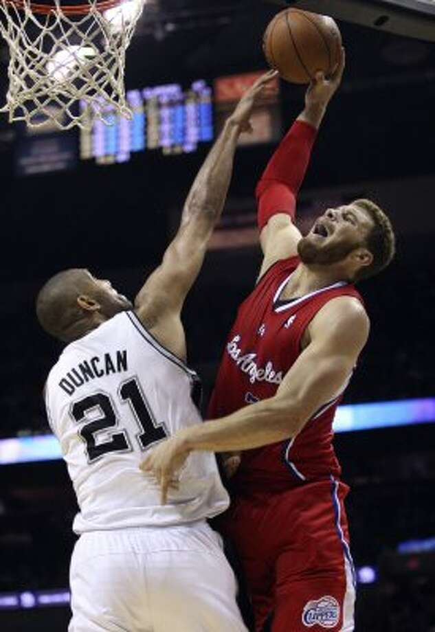 Los Angeles Clippers' Blake Griffin (32) goes to the basket against San Antonio Spurs' Tim Duncan (21) during the second half of game two of the Western Conference semifinals at AT&T Center, Thursday, May 17, 2012.  Jerry Lara/San Antonio Express-News (San Antonio Express-News)