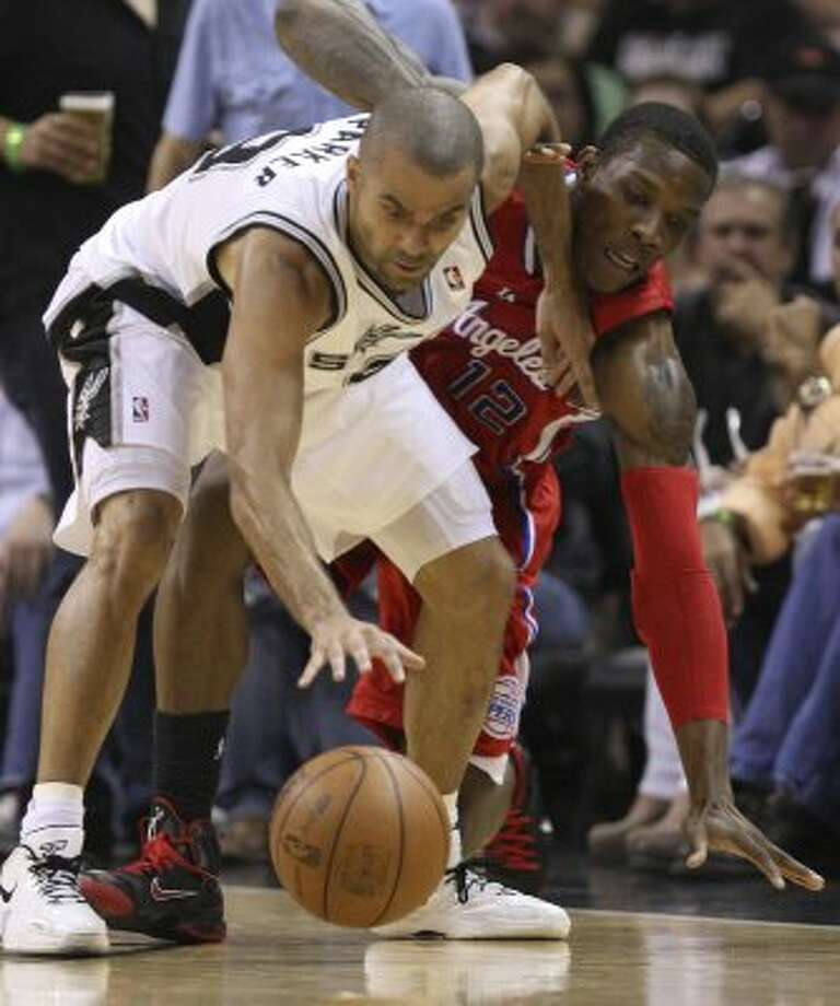 San Antonio Spurs' Tony Parker (9) and  Los Angeles Clippers' Eric Bledsoe (12) fight for a loose ball during the second half of game two of the Western Conference semifinals at AT&T Center, Thursday, May 17, 2012.  Jerry Lara/San Antonio Express-News (San Antonio Express-News)