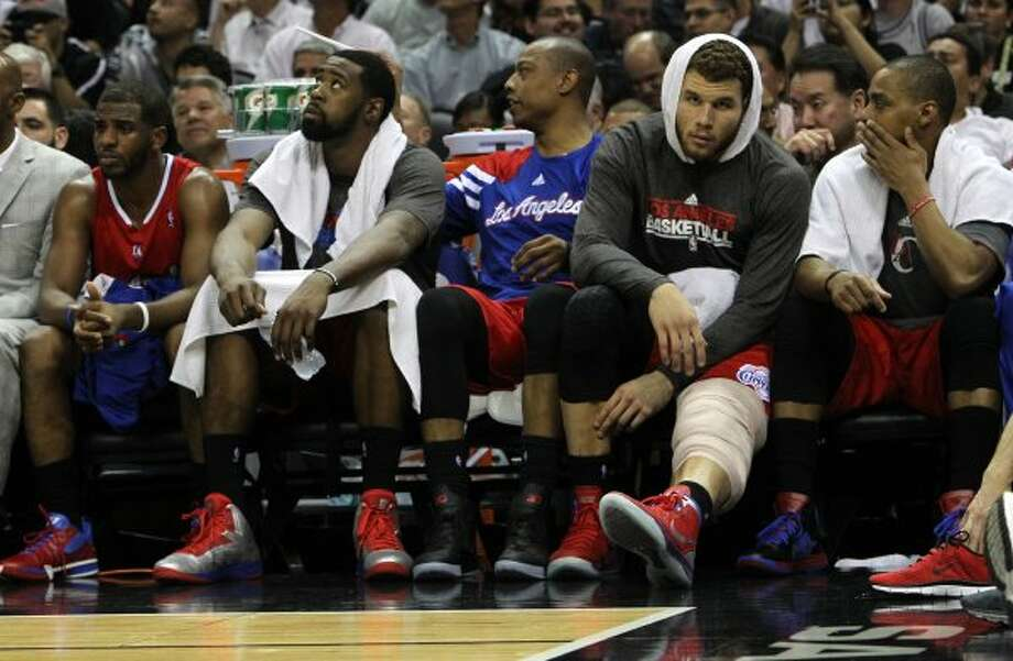 Los Angeles Clippers' Blake Griffin, right, rests on the bench in the second half of game two of the Western Conference semifinals at the AT&T Center on Thursday, May 17, 2012.  The Spurs won 105-88.  Kin Man Hui/Express-News (SAN ANTONIO EXPRESS-NEWS)