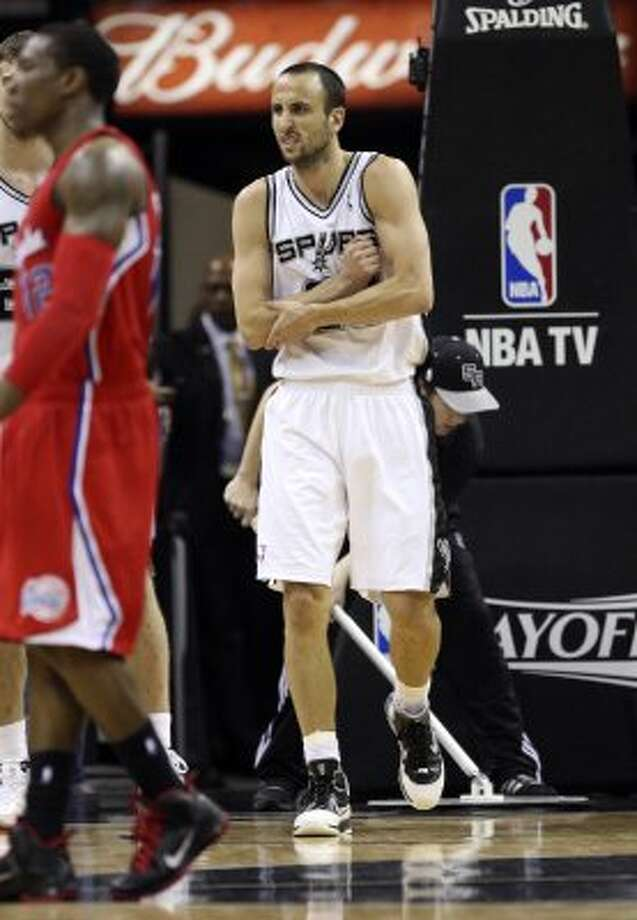 San Antonio Spurs' Manu Ginobili (20) holds his elbow after a play during the second half of game two of the Western Conference semifinals at AT&T Center, Thursday, May 17, 2012.  Jerry Lara/San Antonio Express-News (San Antonio Express-News)