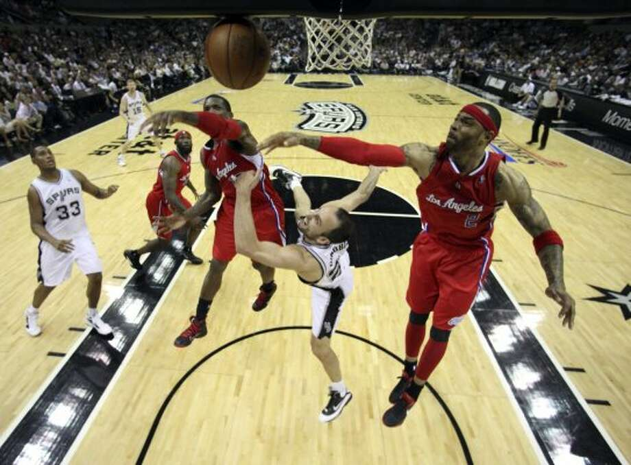 San Antonio Spurs' Manu Ginobili (20)  is fouled going to the basket by  Los Angeles Clippers' Kenyon Martin (2) with  Los Angeles Clippers' Eric Bledsoe (12) in pursuit during the second half of game two of the Western Conference semifinals at AT&T Center, Thursday, May 17, 2012.  The Spurs won 105-88.  Jerry Lara/San Antonio Express-News (San Antonio Express-News)