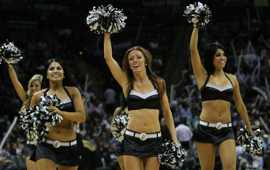 Spurs' SilverDancers wave to fans in the second half of game two against the Los Angeles Clippers of the Western Conference semifinals at the AT&T Center on Thursday, May 17, 2012. Kin Man Hui/Express-News (SAN ANTONIO EXPRESS-NEWS)