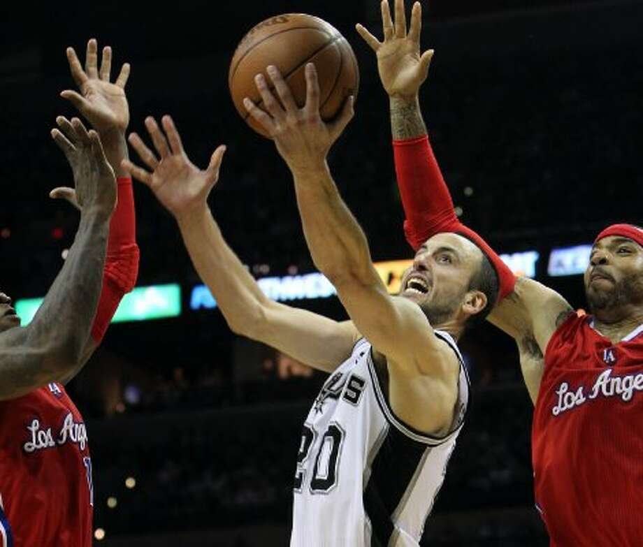 San Antonio Spurs' Manu Ginobili (20) drives to the basket between  Los Angeles Clippers' Eric Bledsoe (12) and Kenyon Martin (2) in the second half of game two of the Western Conference semifinals at the AT&T Center on Thursday, May 17, 2012.  The Spurs won 105-88.  Kin Man Hui/Express-News (SAN ANTONIO EXPRESS-NEWS)