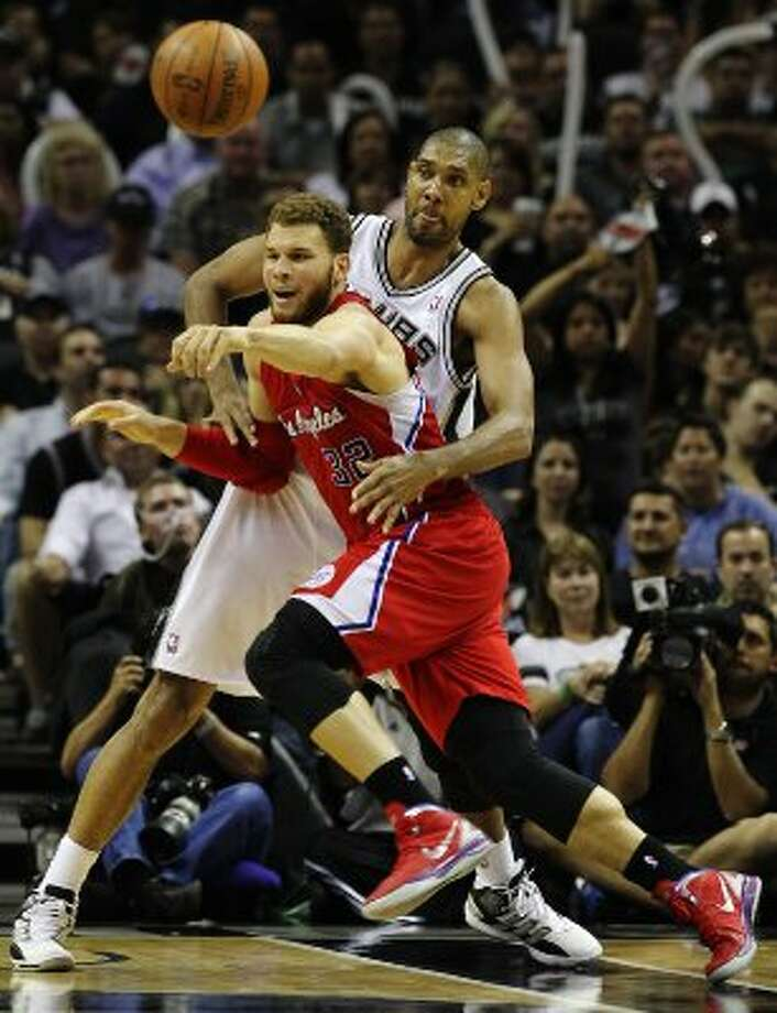 San Antonio Spurs' Tim Duncan (21) puts pressure on  Los Angeles Clippers' Blake Griffin (32) in the second half of game two of the Western Conference semifinals at the AT&T Center on Thursday, May 17, 2012.  The Spurs won 105-88.  Kin Man Hui/Express-News (SAN ANTONIO EXPRESS-NEWS)